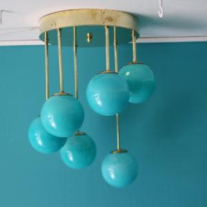 Lustre design mid-century en laiton et globes en verre de Murano bleu turquoise